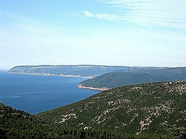 Cape Breton coastline & fish baot to sea.jpg