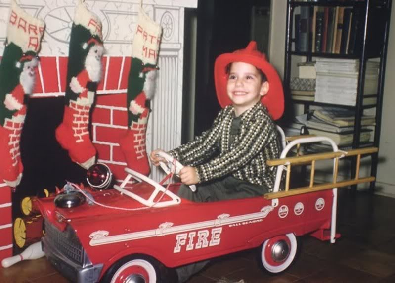 kid in fire truck 2.jpg