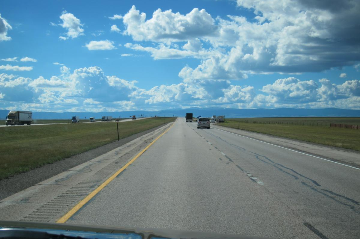 CA vacation - I-80 Wyoming, straight road and rock formations (2).JPG