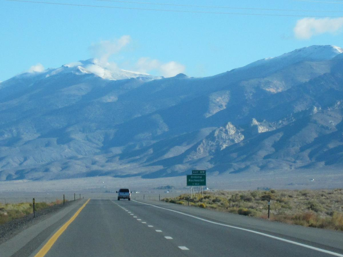 CA vacation - I-80 Eastbound, snow capped mountains in NV.JPG