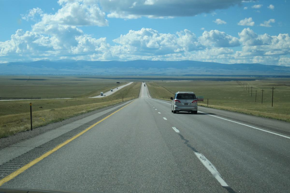 CA vacation - I-80 Wyoming, straight road and rock formations (3).JPG