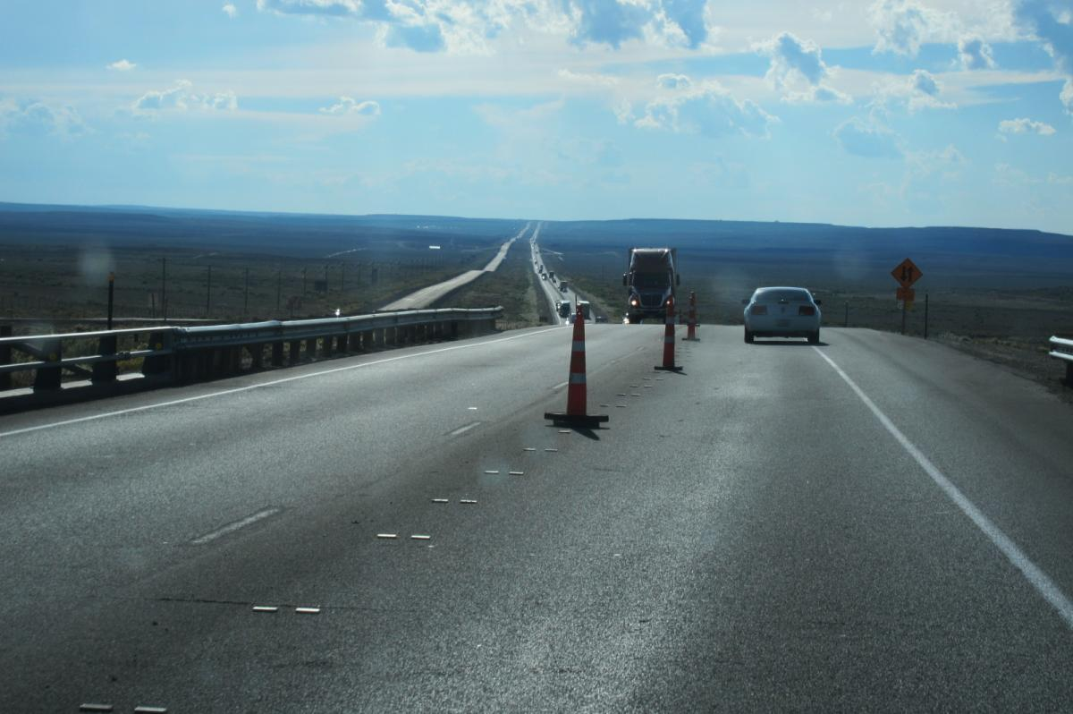CA vacation - I-80 Wyoming, straight road and rock formations (7).JPG