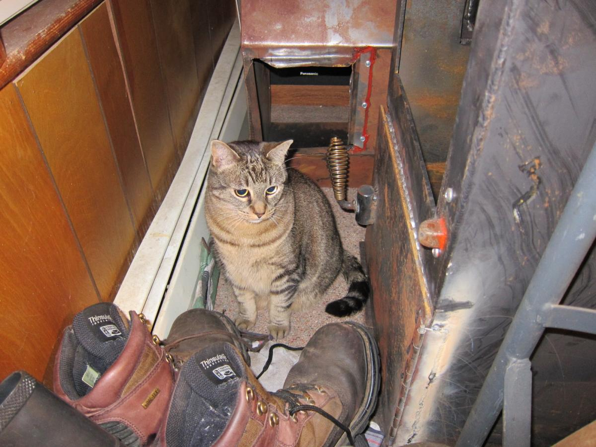 Inga in the shoes, next to stoker boiler.JPG